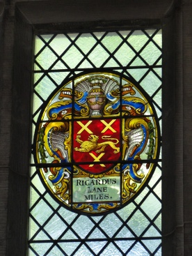 "Richard Lane's Armorial glass in the windows of Middle Temple Hall. This is different than his Readership armorial panel on the walls below - it was the updated with the Lion by Charles II. The word ""miles"" means he was a Knight."