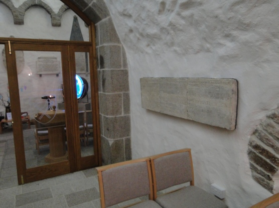 The tomb marker of Maximillian Norreys on the wall of the North Chapel. It has been moved at least twice, and its original placement is unknown.