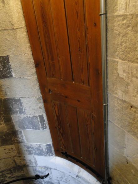 The closed door of the stairwell hide