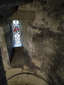 slit window in the bell tower facing outside