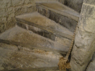 The foot of the stairs of the bell tower