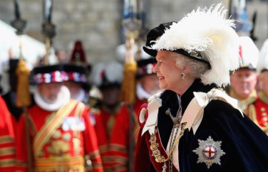 Queen Elizabeth II in a modern St. George's Day parade wearing the dark blue mantle (cape) with the insignia of the Noble Order of the Garter on the left shoulder