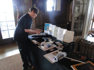 My nephew Tate, setting up the commemorative pens we shared with the guests of the talk, along with the supporting elements on display.